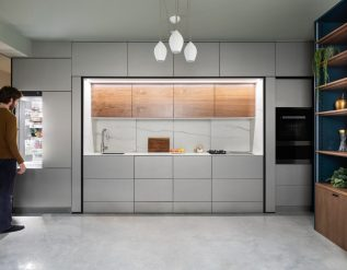 a-wall-of-minimalist-cabinets-keeps-this-kitchen-hidden-away