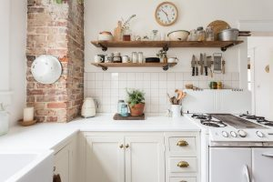 The Best Ways to Breathe Life Into an All-White Kitchen, According to Designers