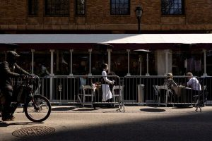 Eating al fresco at a Philadelphia restaurant last week.  Economists expect the labor market to improve as vaccine adoption accelerates and more states lift business restrictions.