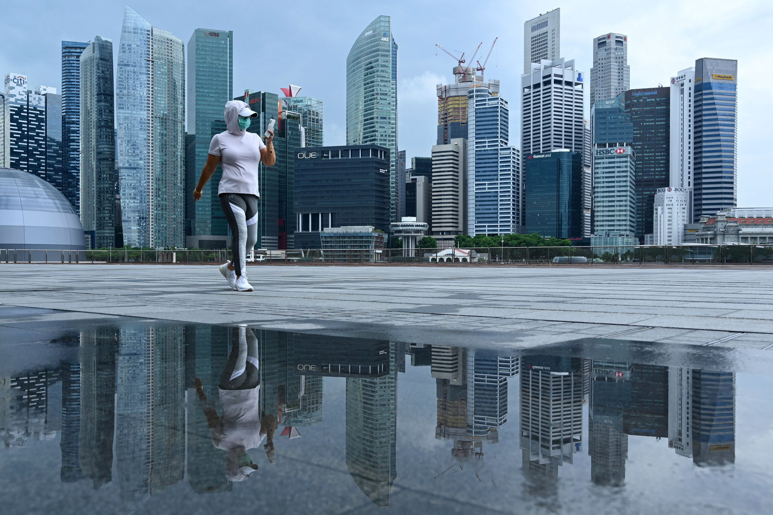 singapore-to-start-easing-covid-restrictions-as-daily-infections-fall